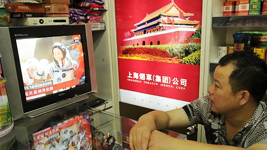 Man watches TV in China