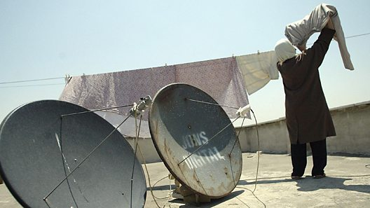 Satellite aerials on a roof-top in Iran